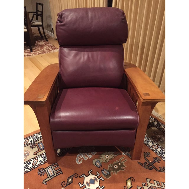 Gustav Stickley: Bustle Back Bow Arm Morris Recliner. A slat sided recliner with bustle back cushion, in cherry with...