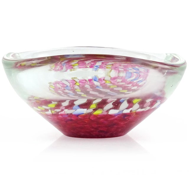 Beautiful Murano hand blown twisted blue, pink, yellow, and aventurine ribbons Italian art glass bowl. The ribbons hover...