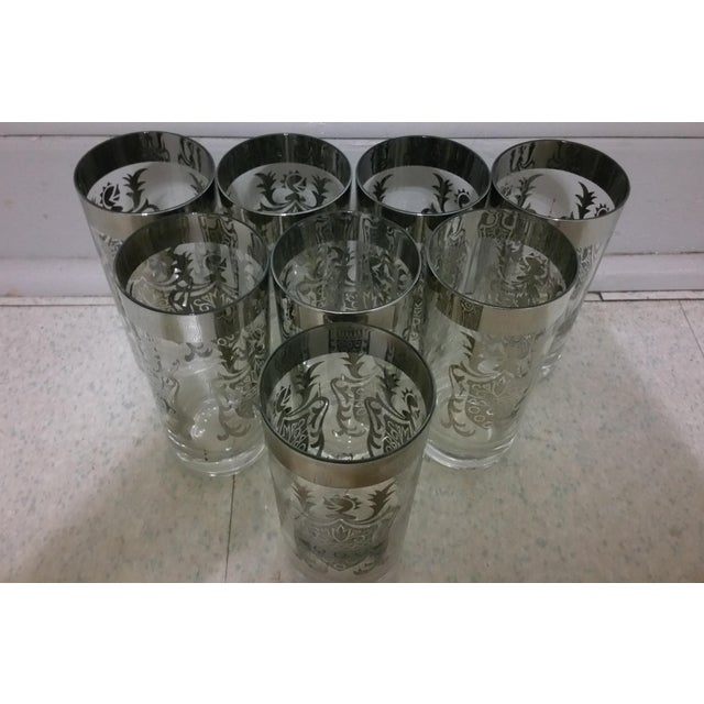 Here's an elegant set of 8 silver highball glasses in the original packaging. These were made by Queen's Lusterware and...