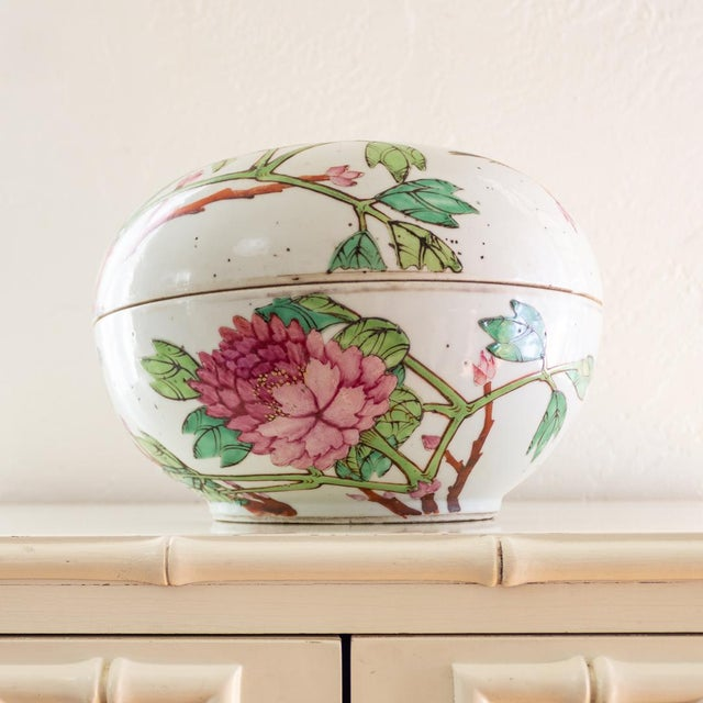 Qing Dynasty large porcelain covered box features famille rose enameled subjects popular to the Guangxo period (mid to...