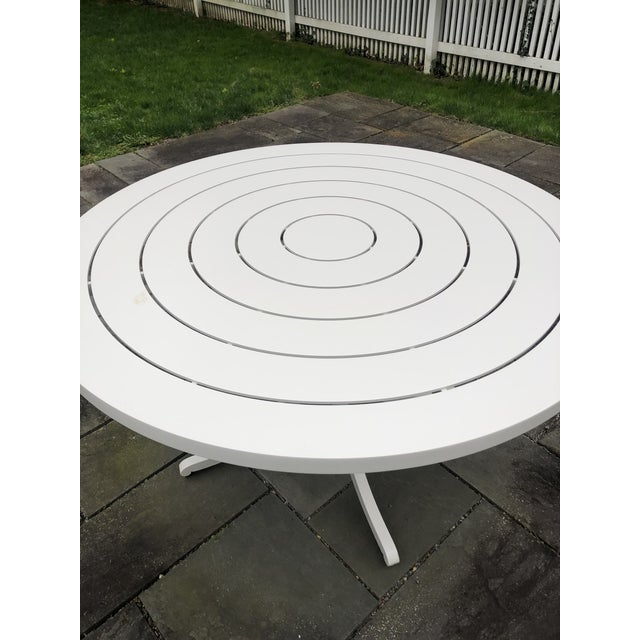 Chic round outdoor painted aluminum dining table bought 4 years ago for about $11K from McKinnon & Harris, the...
