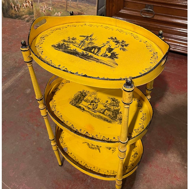This colorful table was crafted in France circa 1960. Made of metal, the occasional table stands on rounded tapered legs...