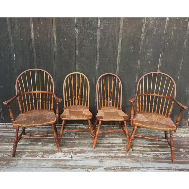 This gorgeous four-piece pine set is comprised of two beautiful Windsor arm chairs and two brace-back chairs; all with...