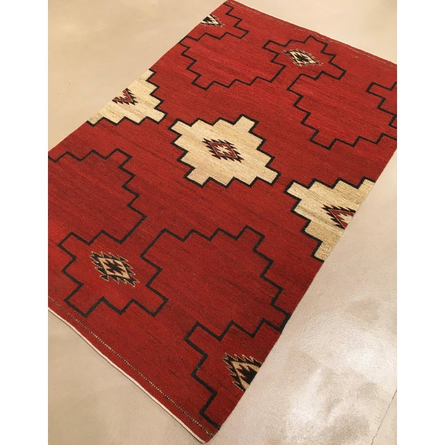 A hand knotted wool flat-weave rug design in a Native American inspired design. Tightly knotted with good wool, this is a...