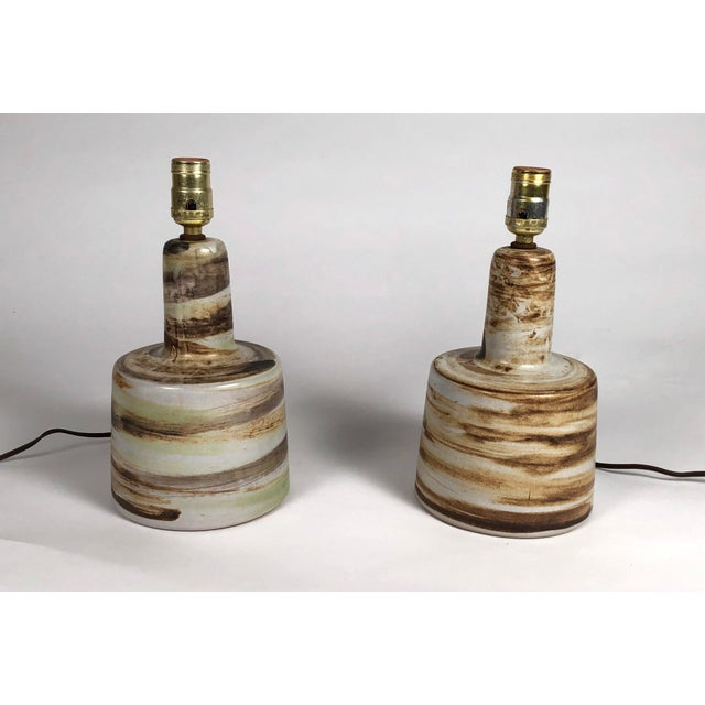 A pair of Jane and Gordon Martz art pottery lamps, each of stepped cylindrical form with a larger flared circular base and...