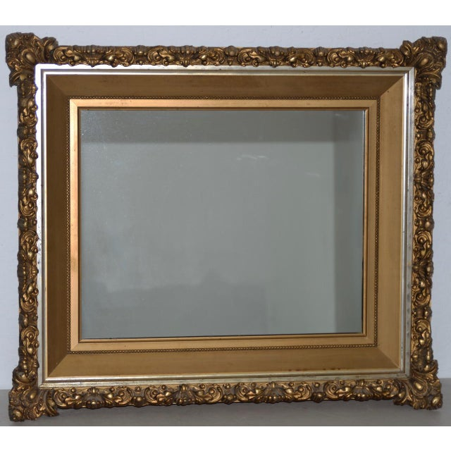 Elaborate 19th Century Carved & Gilded Frame with Mirror c.1890s You can hang this mirror vertical or horizontal. The...