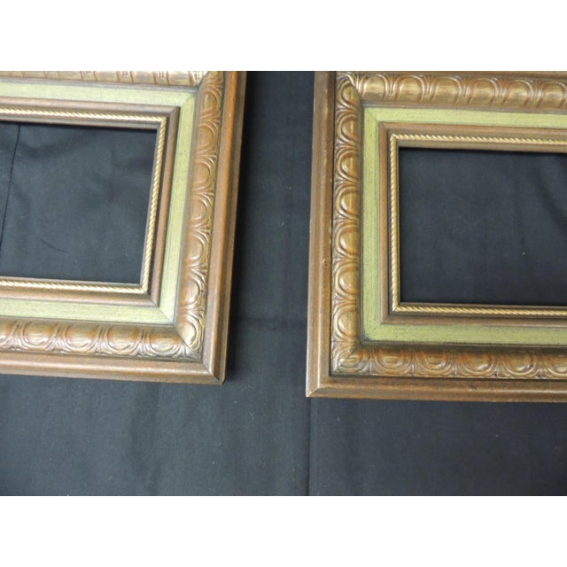 Set of (3) vintage green painted wood art frames with hanging hooks in the back. Carved wood with green painted accents....