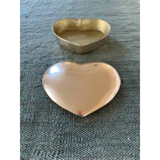 Beautiful brass heart shaped trinket box.Perfect for on top of a dresser to hold your earrings and rings, or the perfect...