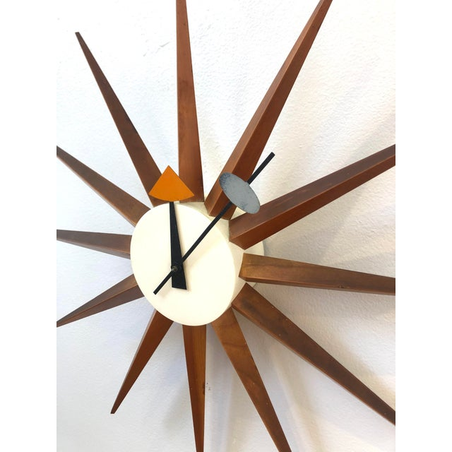This is an iconic George Nelson for Howard Miller clock is in stunning original condition. The cord has been shortened by...