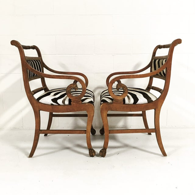 This lovely, unique pair of armchairs is breathtaking and oh so comfortable. The exquisite carving on the curled arms and...