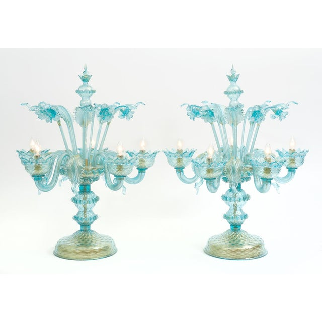 Gold flecks design details with brass base Venetian glass pair of flambeau table lamps. Each lamp is in excellent working...