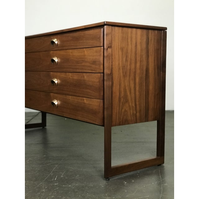 Nicely constructed and designed walnut sideboard by Jens Risom. 1960's. Refinished. Very nice condition. Solid...