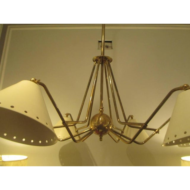 Custom six-light brass and tole fixture in the Mid-Century manner.