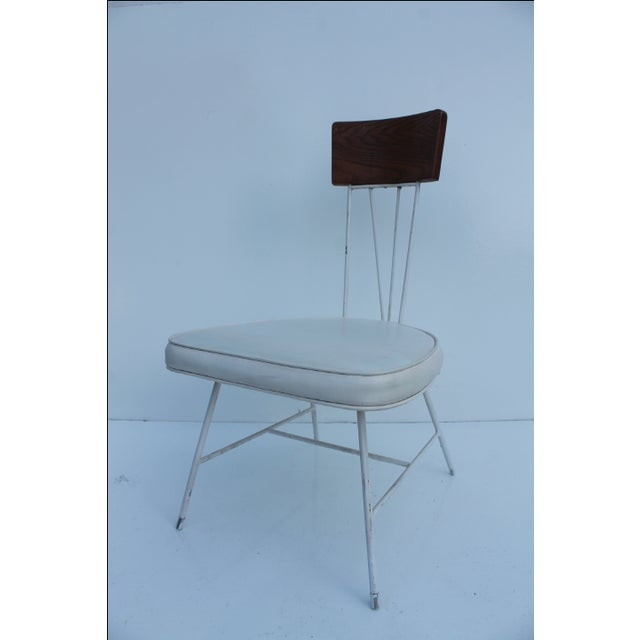This is an iconic 1950's Paul McCobb style chair by designer Richard McCarthy. The iron base and hairpin legs look...