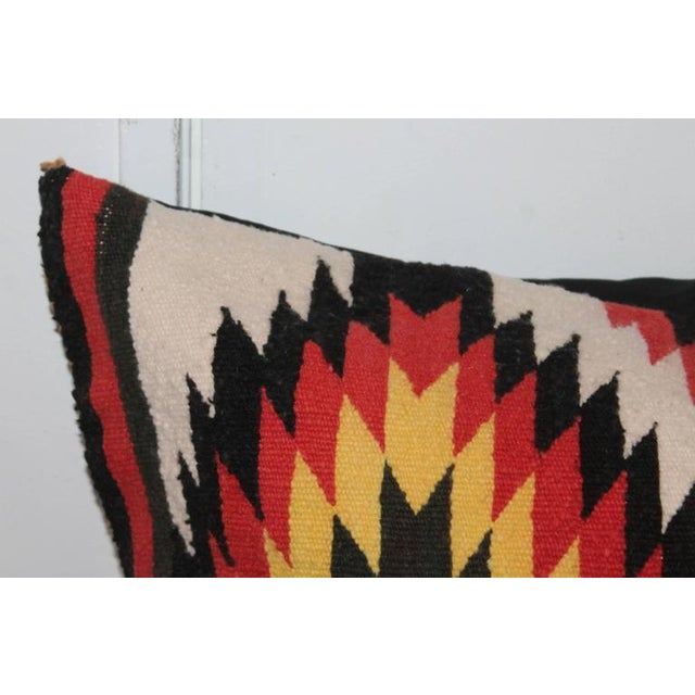 This large Navajo Indian weaving double eye dazzler bolster pillow is in great condition. It has a black cotton linen...