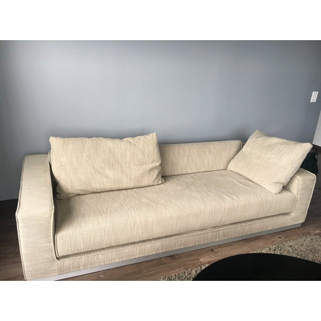 Oatmeal boucle colored down couch with storage. Adjustable back to fold down to convert to Sofa Bed. Storage space under...