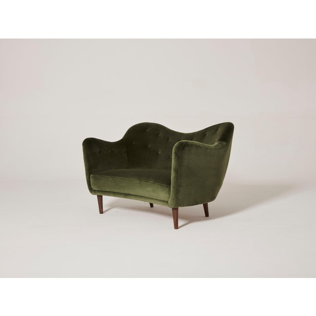 An elegant and rare organic Finn Juhl BO55 (sometimes referred to as model BO64) sofa or loveseat, reupholstered in green...