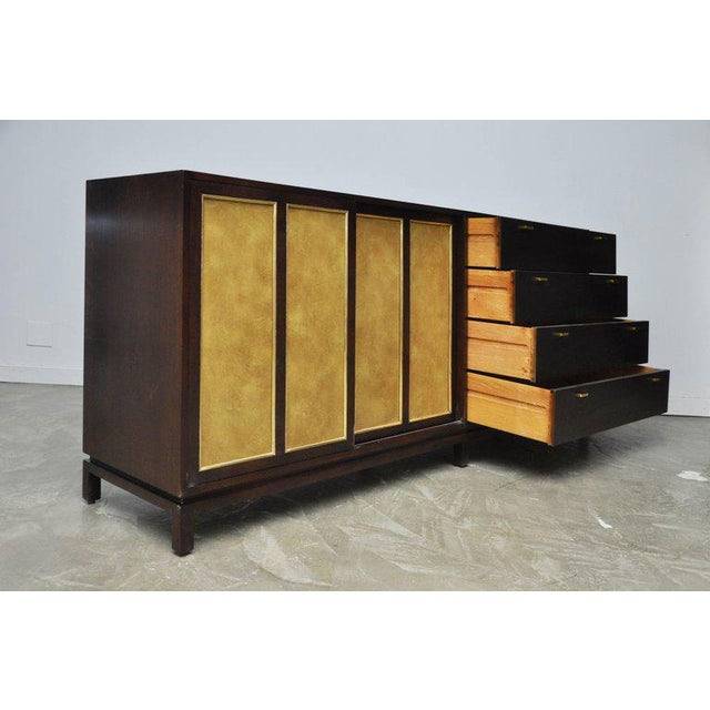 Long credenza by Harvey Probber. Fully restored. Refinished in espresso tone with original goldenrod aluminum doors.