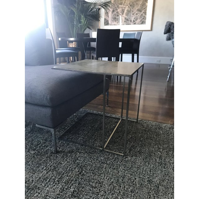 Minotti side table in lapped plate metal. This is the Leger model. This chic Italian side table is as stylish as it is...