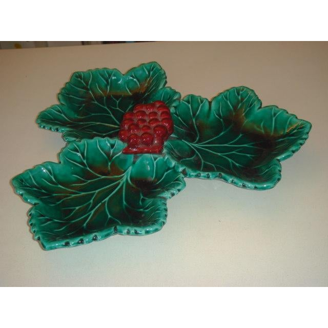 """Circa 1960 green ceramic dish with red ceramic grappe signed """"V"""" Vallauris France. Vallauris is a small village close to..."""