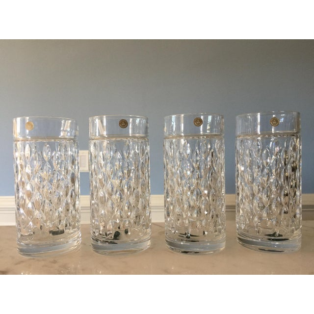 Just in time for your holiday tablescape! Timeless grandeur is in your hands with Aston highball glasses. Cut with a...