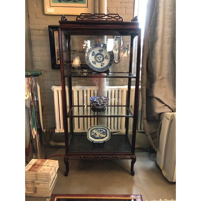 19th century hand carved Chinese rosewood curio or display cabinet. There is a door on either side and the crown top lifts...