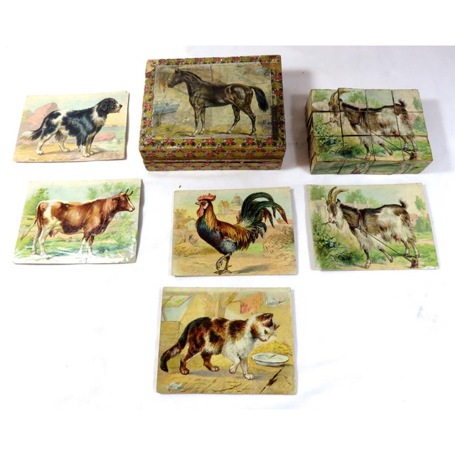 A Victorian Child's Farm Yard Animals Wood Block Puzzle Set. The Animal Scenes are done in Early chromolithograph style...