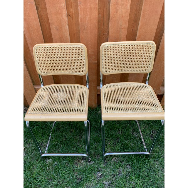 Pair of cesca Breuer style cane + chrome counterstool from gabberts. Both seats have damage to cane, see photos. One is a...