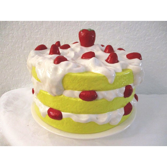 Absolutely magnificent, vibrant ceramic cake plate in a strawberry shortcake motif. Lid lifts off cream-shaded pedestal...