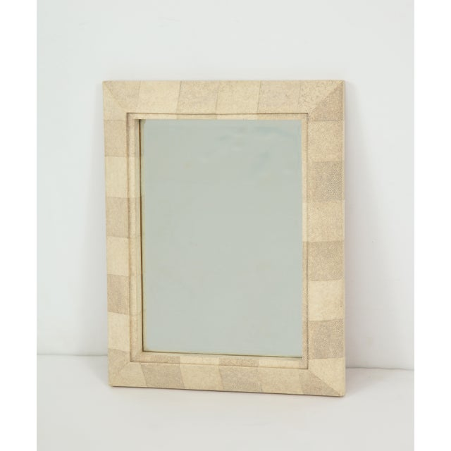 Wall mirror with bevelled shagreen frame and wooden back. Made in the Philippines for R & Y Augousti of Paris, c. 1990's.