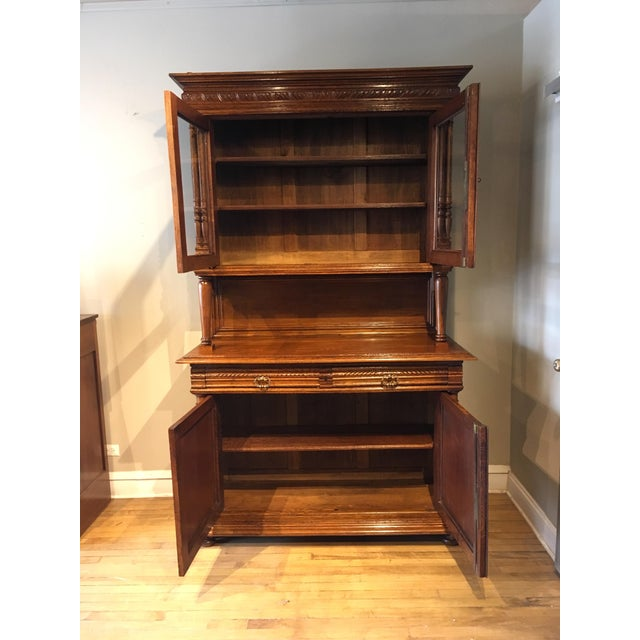 The 19th-century French oak hand-carved cabinet. It has interior shelving behind all of the doors two on top and one on...