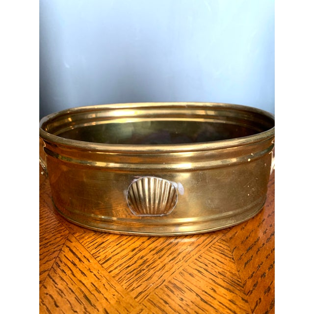 Pretty vintage shell motif brass planter with handles. Aged golden brass patina-a perfect addition to brighten your decor!...