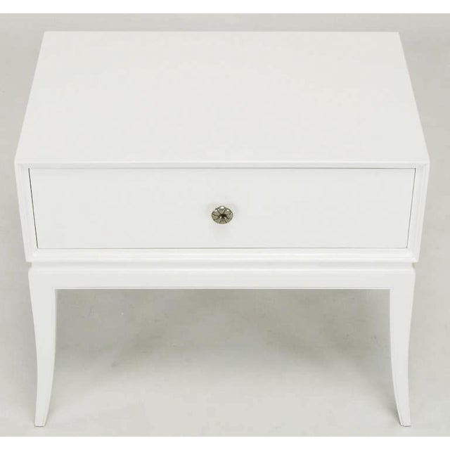 Petite night table from Parzinger's Charak Modern line. Restored, with fresh white lacquer and replated nickel pull.