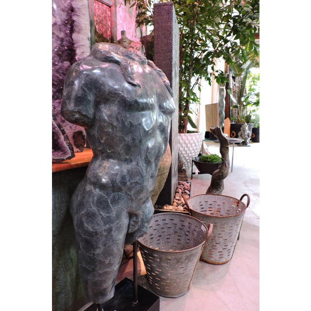 Patina'd bronze male torso fragment designed by Luciano Tempo. Comes with stand.
