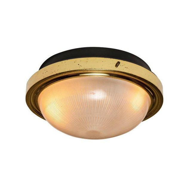1960s Sergio Mazza brass and glass wall or ceiling light for Artemide. Minimalist Italian design executed in rare brass,...