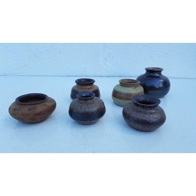 Vintage mid-century modern art handmade decorative studio pottery small vases, set of 6. All pieces are signed on the...