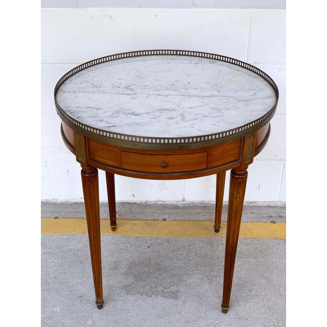 """Louis XVI style Carrara marble-top Bouillotte table, stamped made in France With pierced brass gallery, with 8.5"""" W x 3"""" H..."""