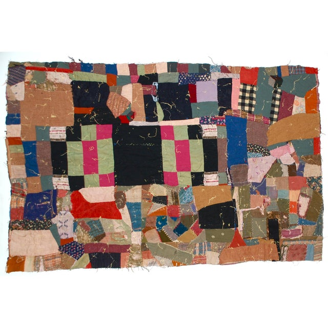 A fantastic antique Victorian crazy quilt with mixed textiles. The hand-stitched quilt with a variety of textiles,...