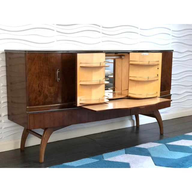 "Gorgeous and rare English mid century modern credenza, cocktail bar cabinet with art deco influence by ""Beautility"". Made..."