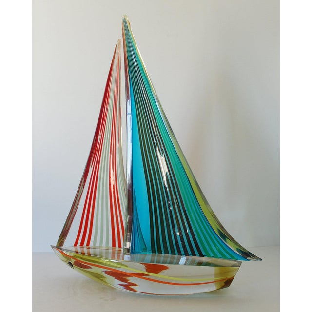 """Vintage multi-color Murano glass sailboat, by Alberto Dona. Signed """"Alberto Dona'"""" on the base of the boat. / Made in..."""
