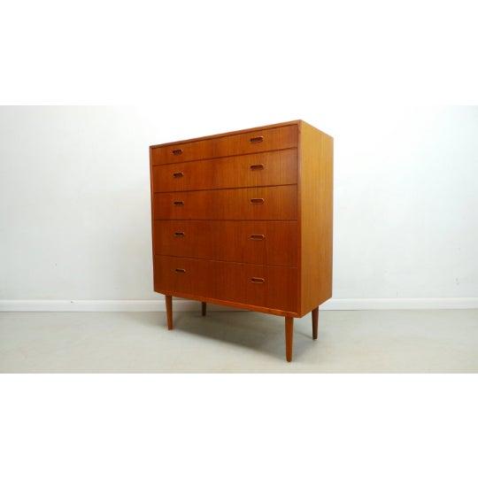 Beautiful mid-century Danish modern teak tallboy chest 5 drawer dresser by Falster of Denmark. This very simple yet modern...