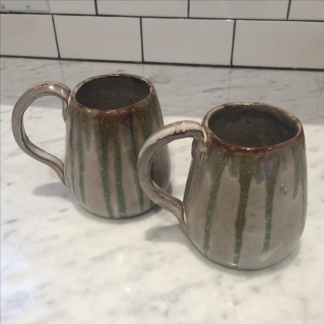 Pair of oversized coffee cups handmade with red clay and beautifully glazed. Signed by Lynn on bottom.