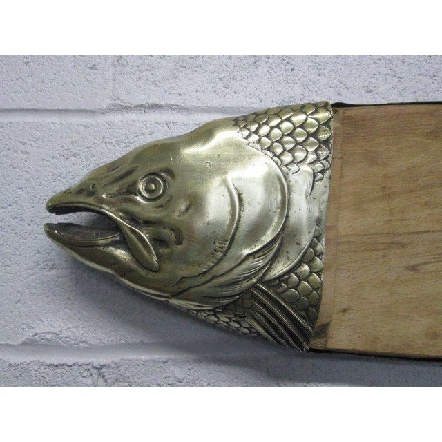 Unique bronze fish cutting or cheese board or platter. Has original patina, original maple board and has a nice size.