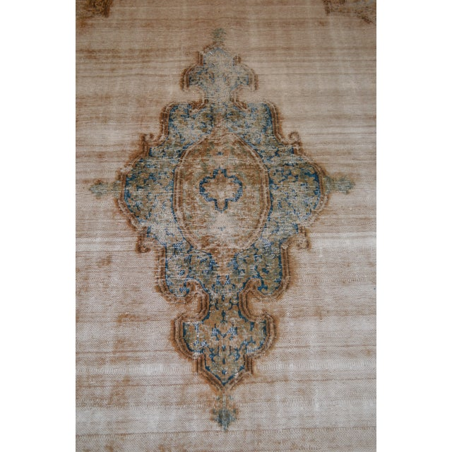 Vintage Kerman rugs are known for the refinement of their weave and the elegant designs. The palettes are extremely...