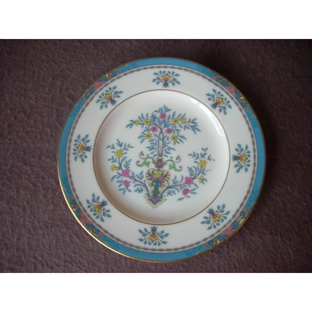 """fine translucent china in the traditional """"Blue Tree"""" pattern; bright gold rims frame a border of sky blue against classic..."""