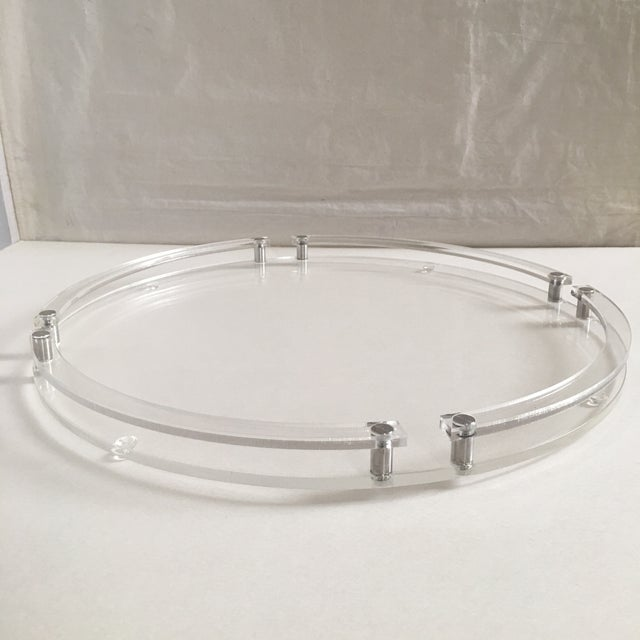 Modern round lucite and metal tray believed circa 1980's or later. Works well with many decor styles, both traditional and...