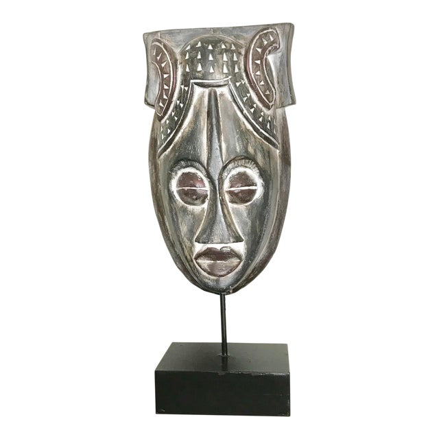 African Mask on a Wood Stand For Sale