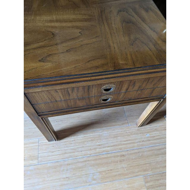 Drexel campaign end tables or nightstands. Original finish in excellent vintage condition. Original inlaid brass pulls....