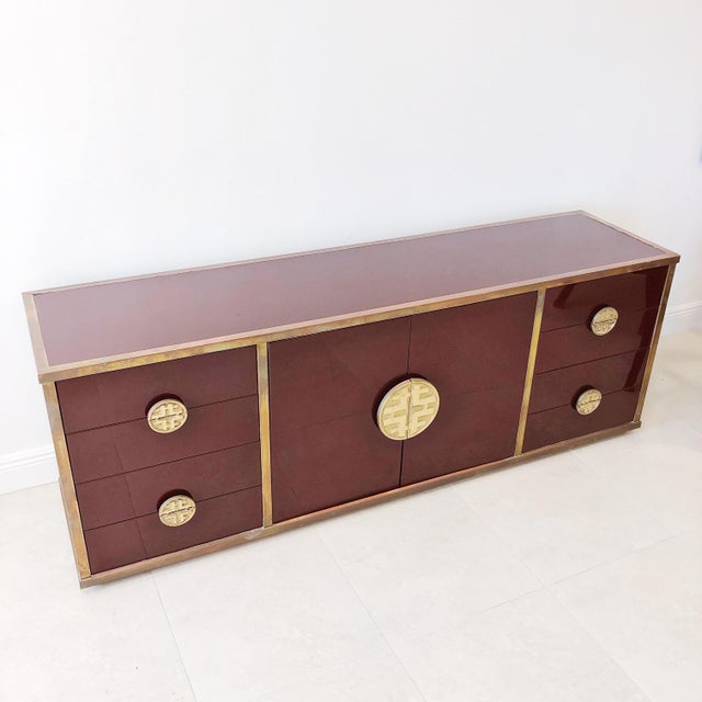 Mid century lacquered wood credenza with Asian Inspired hand cast bronze hardware by Architect Giacomo Sinopoli for...