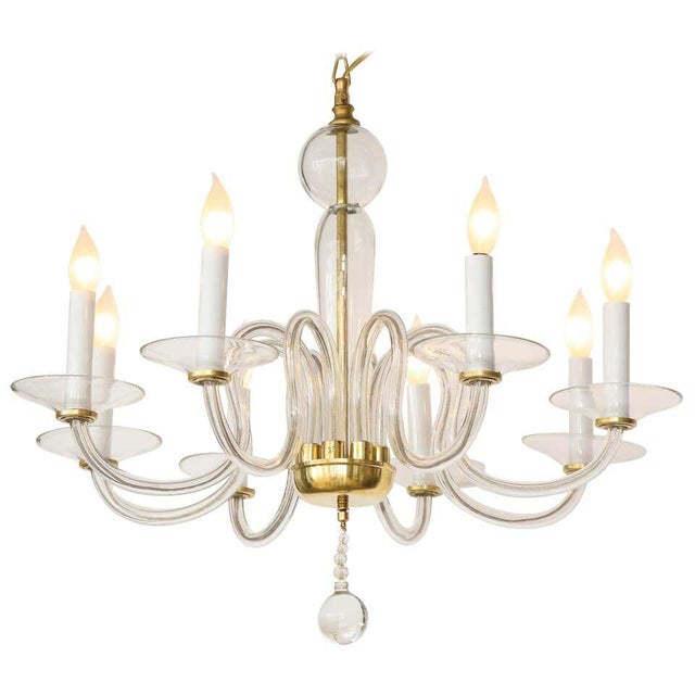 A Murano Mid-Century Modern hand blown glass chandelier with eight arms with brass supported bobeche, stem and base canopy...